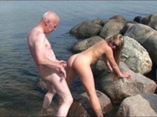 Grandpa Ulf Larsen,  fuck two 19 year old teen whores on public beach